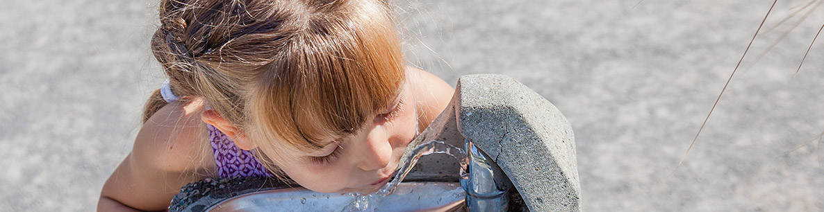 girl drinking clean water from a fountain