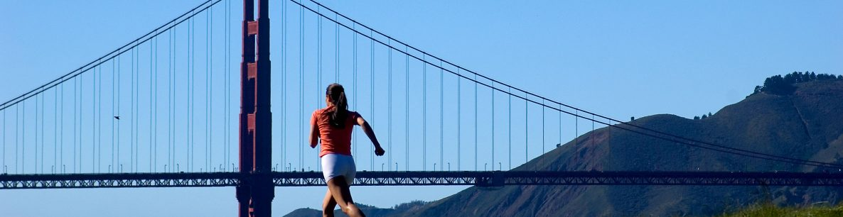 woman running near Golden Gate Bridge
